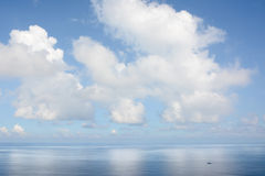 Clouds above a surface of the sea Stock Images