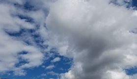 Clouds above. White clouds in clear sky. Heavens gate Stock Photos