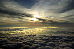 Clouds Aerial. In flight between cloud layers as the sun gets low in the sky royalty free stock images