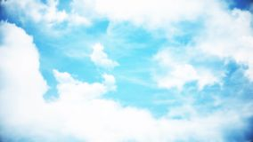 Clouds with the afternoon sun. Animation of clouds in the blue sky.  Stock Images