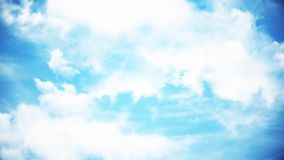 Clouds with the afternoon sun. Animation of clouds in the blue sky.  Stock Photography