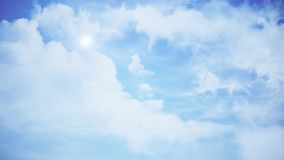 Clouds with the afternoon sun. Animation of clouds in the blue sky.  stock photo