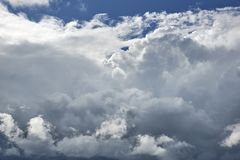 Clouds against blue sky as abstract background . Horizontal shot of large clouds against the blue sky stock images