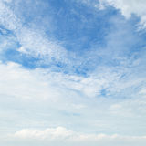 Clouds against the blue sky Stock Photography