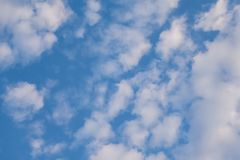 Clouds against the blue sky. Sunshine space bright summer day outdoors light heaven clear high environment color weather season air wind peace spring breeze royalty free stock image