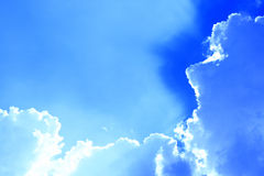Clouds against a bright blue sky Royalty Free Stock Image