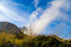 Clouds against mountain background at dawn in Sicily Stock Photos