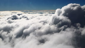 In the clouds Stock Images