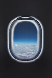 Clouds in the aircraft's porthole Stock Image
