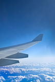 Clouds in the aircraft's porthole. Clouds and wing in the aircraft's porthole Stock Image