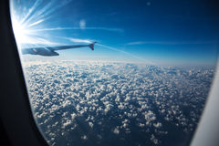 Clouds through an aircraft window Stock Photos