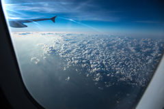 Clouds through an aircraft window Stock Image