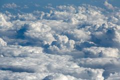 Clouds from the airplane porthole royalty free stock photo