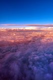 Clouds from an airplane. View colored clouds from an airplane at dawn Royalty Free Stock Photo
