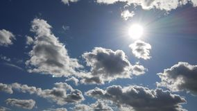 Clouds amidst the sun Stock Photography