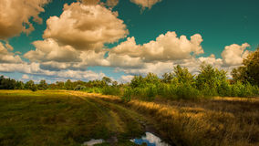 Clouds anf trees Royalty Free Stock Image