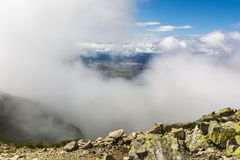 In the clouds he appeared in the valley. Stock Photos