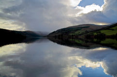 The clouds and approaching snow is falling across Talybont Reservoir Stock Photos