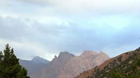 Clouds on a background of mountains. Pamir, Tajik Royalty Free Stock Photo