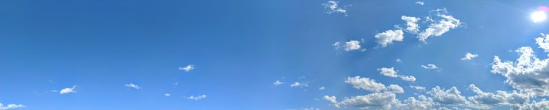 Clouds banner in the blue sky and the sun royalty free stock photography