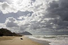 Clouds and Beach. Dramatic Sky over the beach of Sabaudia, Italy Royalty Free Stock Image