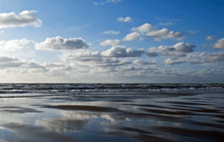 Clouds at the beach. Clouds and reflections at the beach Royalty Free Stock Photography