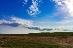 Clouds over field Royalty Free Stock Image