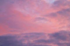 Clouds on beautiful pink evening sky during sunset Stock Photos