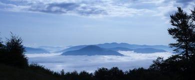 Clouds below in Carpathian mountains stock photos