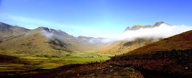 Clouds below the summits Royalty Free Stock Photos