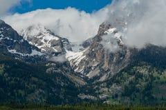Clouds Billow Around Peaks in Teton Range. In Wyoming stock images