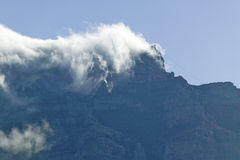 Clouds blow over Table Mountain and mountains behind Cape Town, South Africa royalty free stock image