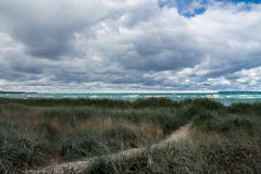 Clouds and Blue Grass. Lake Michigan on a chilly October day Stock Photography