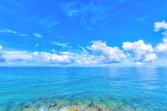 Clouds and blue ocean, tropical island Royalty Free Stock Photo