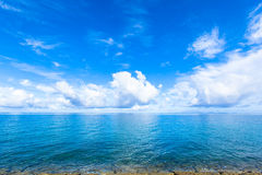 Clouds and blue ocean, tropical island Royalty Free Stock Image