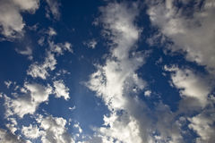 Clouds in Blue Skies Stock Images