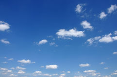 Clouds in the blue sky. White cumulus clouds and a blue sky Royalty Free Stock Image