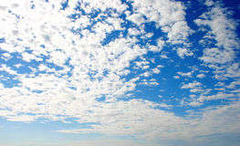 Clouds and blue sky. Pretty blue sky filled with puffy white clouds royalty free stock image