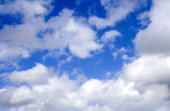 Clouds in a Blue Sky. White Fluffy Clouds In A Blue Sky Stock Photography