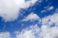 Clouds in a Blue Sky. White Fluffy Clouds In A Blue Sky Royalty Free Stock Photography