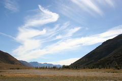 Clouds in blue sky, Arthur's Pass, New Zealand Royalty Free Stock Photo