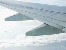 Clouds and sky as seen through window of an aircraft. Clouds and blue sky as seen through window of an aircraft Stock Photos