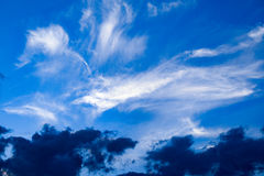 Clouds with a blue sky backdrop. Clouds developing into a storm on a blue sky background Stock Photos