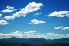 Clouds and blue sky background stock photography