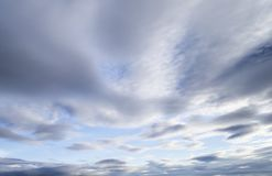 Clouds in the blue sky. Blue sky background with tiny clouds royalty free stock images