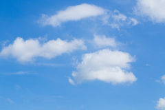 Clouds in the blue sky. Blue sky background with tiny clouds stock photography