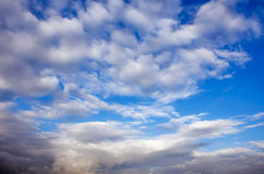 Clouds. Blue sky background with tiny clouds Stock Photos