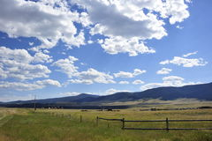 Clouds and blue sky. Beautiful clouds in the blue sky above the meadow in Montana, USA Stock Photography