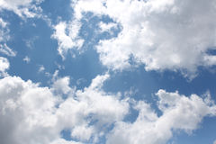 Clouds, Blue Sky, Bright Sun. Puffy white clouds with blue sky and bright sun Stock Photos
