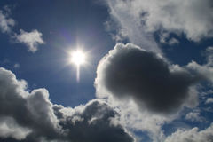 Clouds, blue sky, bright Sun Stock Images